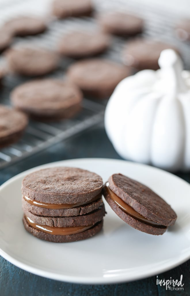Dulce de Leche Chocolate Sandwich Cookies combine spiced chocolate cookies and rich dulce de leche for a delicious fall dessert. #fallcookieweek