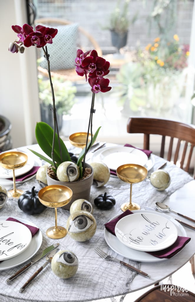 Wicked and Eclectic Halloween Table Setting - spooky chic tablescape decor ideas