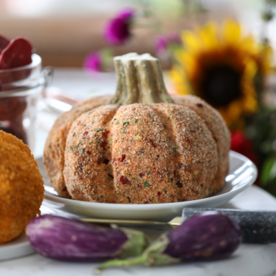 A Sun-Dried Tomato Cheeseball: Fall-inspired and pumpkin shaped cheeseball recipe for entertaining. #cheeseball #sundriedtomato #appetizer #recipe