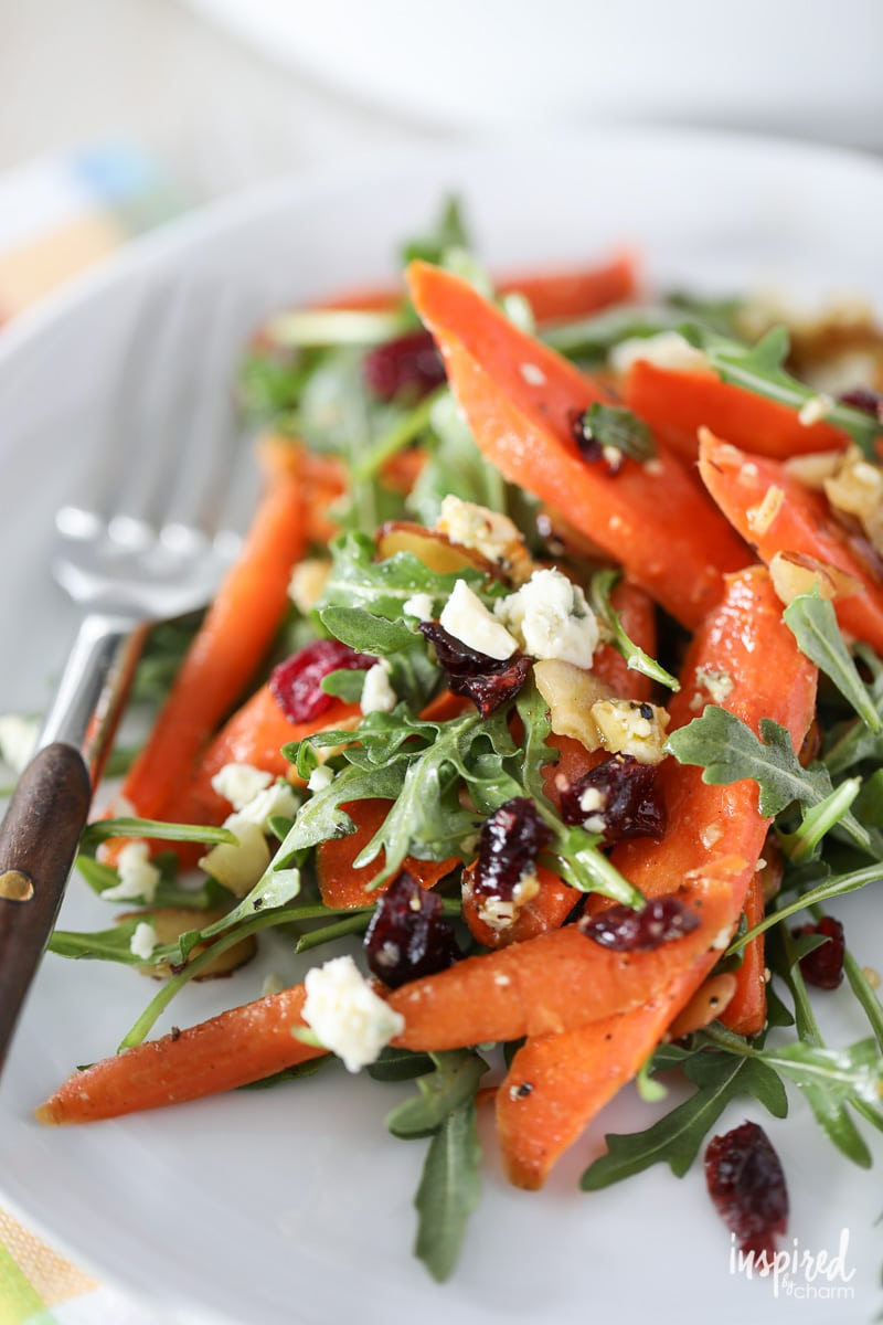 Learn how to make this delicious roasted #carrot #salad #recipe with arugula, blue cheese, dried cranberries, and almonds.