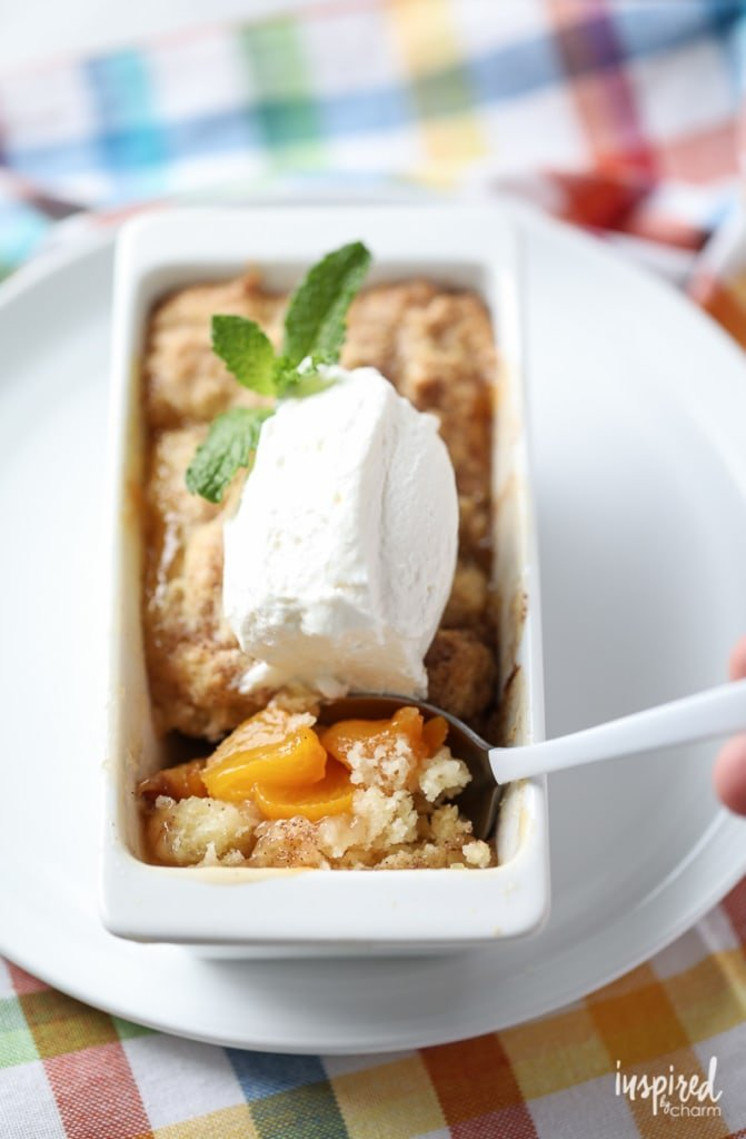Serve up these Mini Peach Cobbler for an adorable and delicious summer dessert! #peach #cobbler #dessert #recipe #peachcobbler