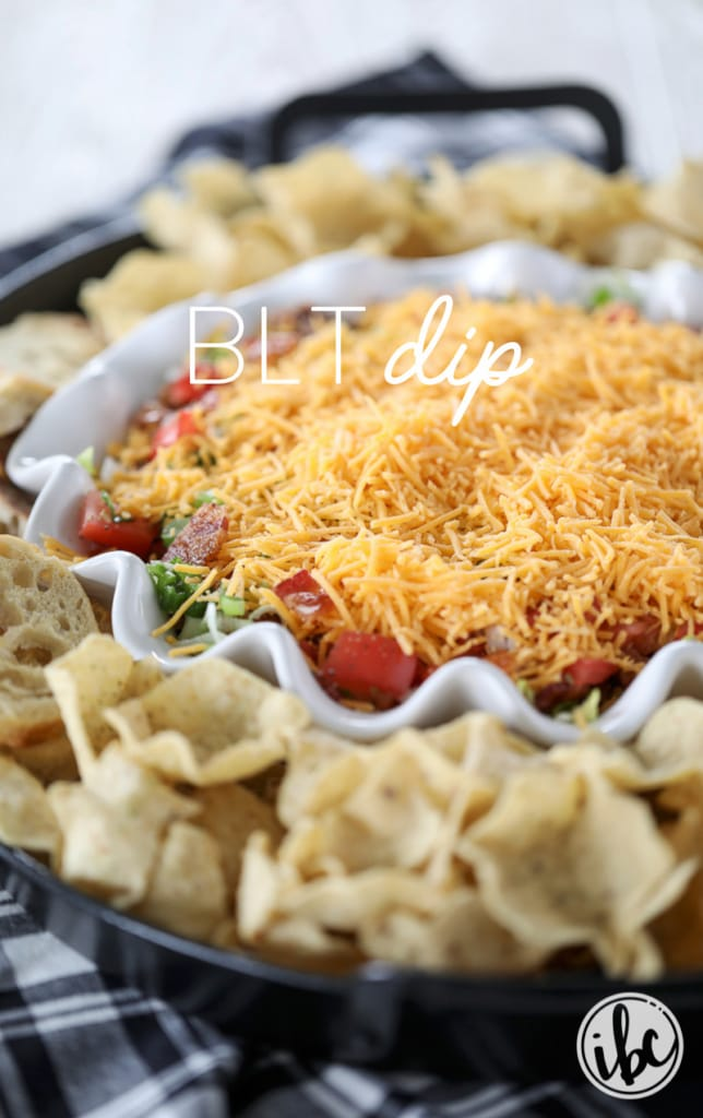 Delicious and easy BLT dip recipe layered with bacon, lettuce, tomato, and cheese! #appetizer #dip #BLT #recipe #bacon