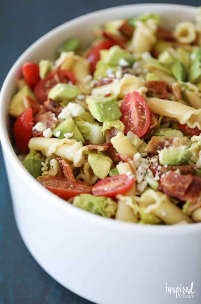 This California Cobb Pasta Salad Recipe with bacon, avocado, blue cheese, romaine, and tomatoes is perfect for summer entertaining! #pasta #salad #recipe #appetizer