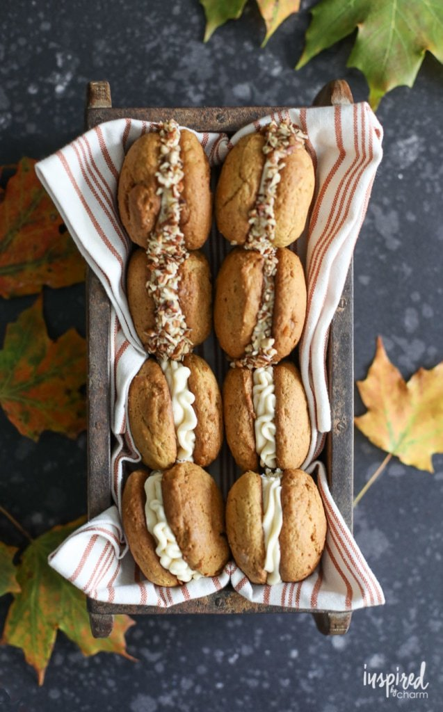 I love these Pumpkin Whoopie Pies with Salted Caramel Cream Cheese Frosting for a delicious fall dessert recipe. #pumpkin #pumpkinspice #fall #baking #dessert #whoopiepie