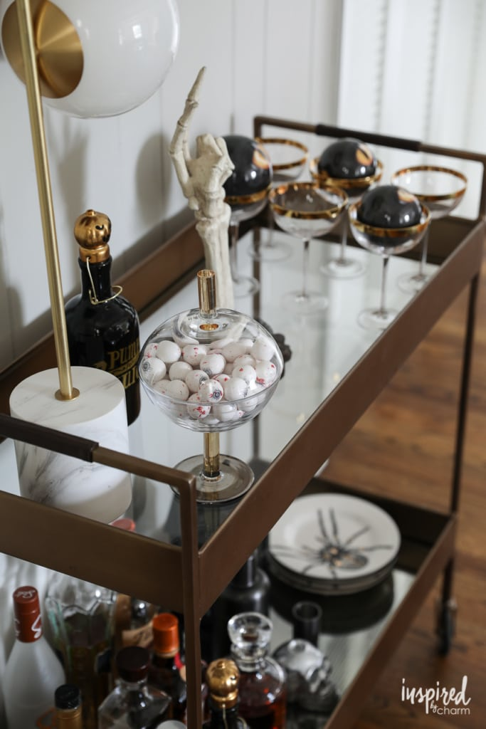 Halloween Bar Cart and Mantel Decor Ideas to Die for #halloween #decor #decorations #spooky #skeleton #mantel