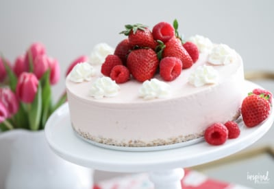 This Strawberry Ice Cream Cheesecake is a delicious summer dessert recipe. #summer #strawberry #cake #cheesecake #icecream #recipe #dessert