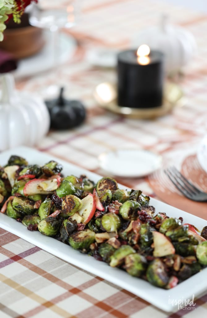 These Roasted Brussels Sprouts with apple, cranberries, and pecans make a tasty fall side dish. #sidedish #fall #recipe #roasted #brusselssprouts #apple #cranberries