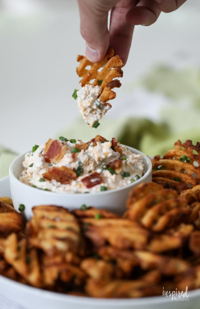 This Loaded Potato Dip served with waffle fries make a delicious and easy appetizer recipe. #loaded #baked #potato #dip #appetizer #recipe #wafflefries